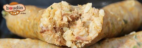 Close up picture of a link of boudin with rice and pork