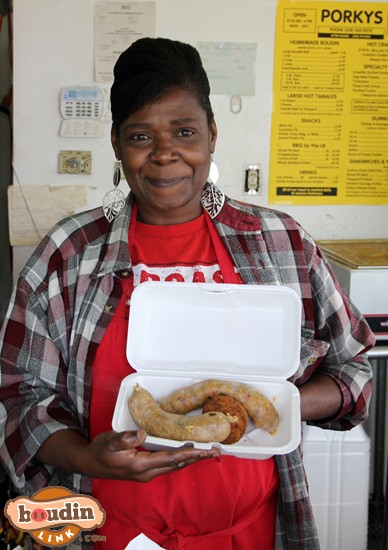 Showing off a plate of hot boudin and a spicy boudin ball.