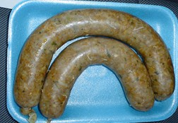 Two links of steaming louisiana boudin.